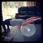 Lisa exercising on her ball